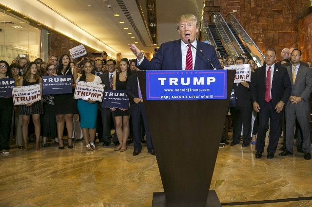 U.S. presidential hopeful Donald Trump speaks during a press availability after signing a pledge with the Republican National Committee (RNC) at Trump Tower in Manhattan, New York September 3, 201 ...
