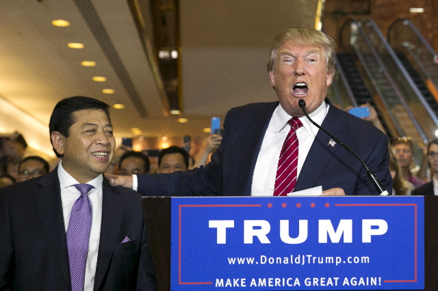 U.S. presidential hopeful Donald Trump (R) stands with Setya Novanto, Speaker of the House of Representatives of Indonesia, following a press availability after signing a pledge with the Republica ...