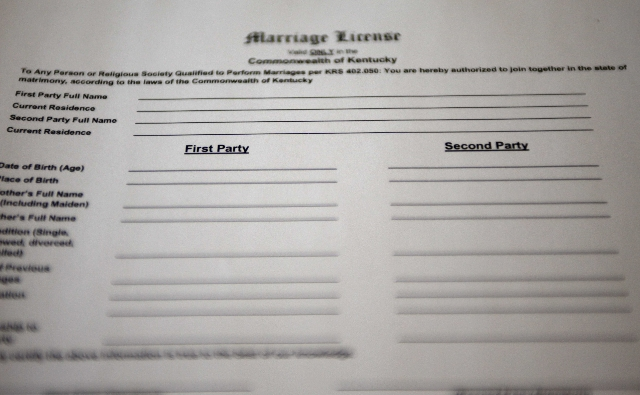 "A copy of a new Kentucky marriage certificate application for same-sex couples, with ""First Party"" and ""Second Party"" replacing ""Bride"" and ""Groom"", is seen ..."