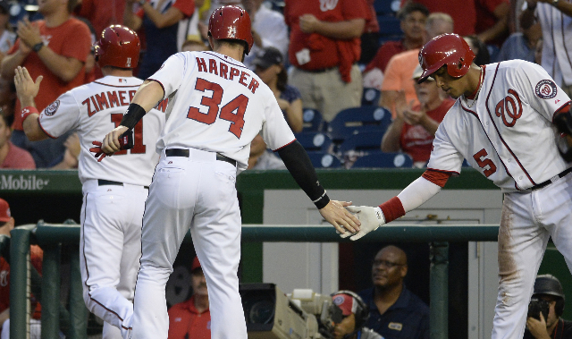 Sep 3, 2015; Washington, DC, USA; Washington Nationals center fielder Bryce Harper (34) celebrates with  third baseman Yunel Escobar (5) after scoring during the first inning against the Atlanta B ...