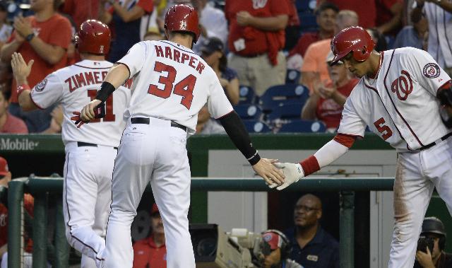 Sep 3, 2015; Washington, DC, USA; Washington Nationals center fielder Bryce Harper (34) celebrates with  third baseman Yunel Escobar (5) after scoring during the first inning against the Atlanta B ...