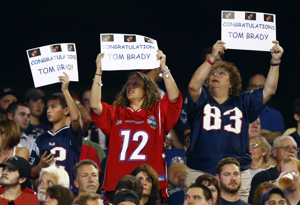 Sep 3, 2015; Foxborough, MA, USA; New England Patriots fans hold up signs in support of quarterback Tom Brady (not pictured) during the first half of a game against the New York Giants at Gillette ...