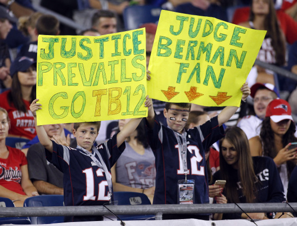 Sep 3, 2015; Foxborough, MA, USA; New England Patriots fans hold up a sign supporting quarterback Tom Brady during the fourth quarter against the New York Giants at Gillette Stadium. Mandatory Cre ...
