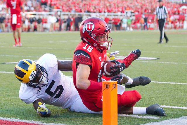 Sep 3, 2015; Salt Lake City, UT, USA; Utah Utes wide receiver Britain Covey (18) is tackled near the goal line by Michigan Wolverines safety Jabrill Peppers (5) during the first half at Rice-Eccle ...