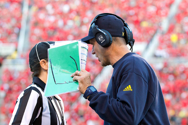 Sep 3, 2015; Salt Lake City, UT, USA; Michigan Wolverines head coach Jim Harbaugh talks with an official during the first half against the Utah Utes at Rice-Eccles Stadium. Mandatory Credit: Russ  ...