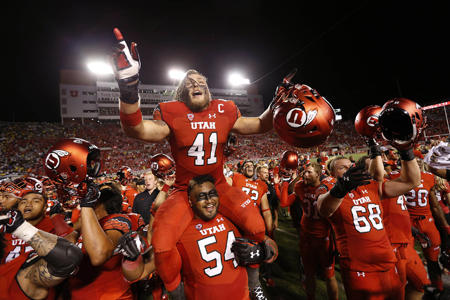 Sep 3, 2015; Salt Lake City, UT, USA; Utah Utes linebacker Jared Norris (41) and offensive lineman Isaac Asiata (54) celebrate their 24-17 win over the against the Michigan Wolverines at Rice-Eccl ...
