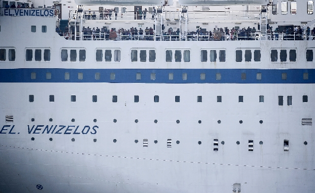 Refugees and migrants are seen onboard the Eleftherios Venizelos passenger ship as it approaches the port of Piraeus, near Athens, Greece, September 4, 2015.  (Reuters)