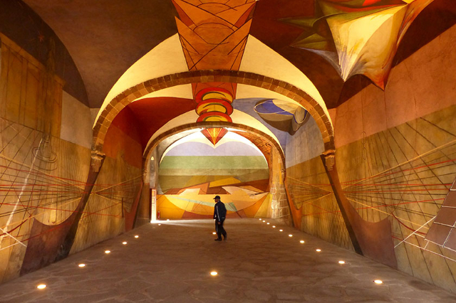 A security guard watches over a cavernous unfinished mural by leading 20th-century Mexican artist David Alfaro Siqueiros at the Bellas Artes (Fine Arts) complex in San Miguel de Allende, Mexico, A ...
