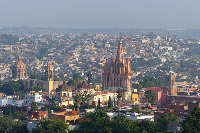 A general view shows landmark churches of San Miguel de Allende, (from L to R) Immaculate Conception, Parroquia and the clock tower marking the  Church of the Clock in San Miguel de Allende, Mexic ...