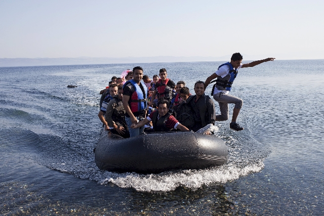 Syrian refugees arrive on a dinghy on the Greek island of Lesbos, September 4, 2015. European Union officials are preparing to push EU governments to take in many more asylum-seekers from pressure ...