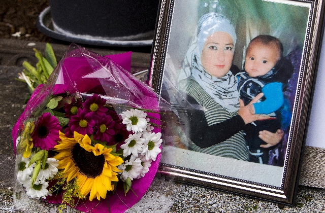 A photograph of Syrian woman Rehan Kurdi holding her son Aylan is pictured next to a bouquet of flowers outside the home of Rehan's sister-in-law Tima Kurdi in Coquitlam, British Columbia Se ...