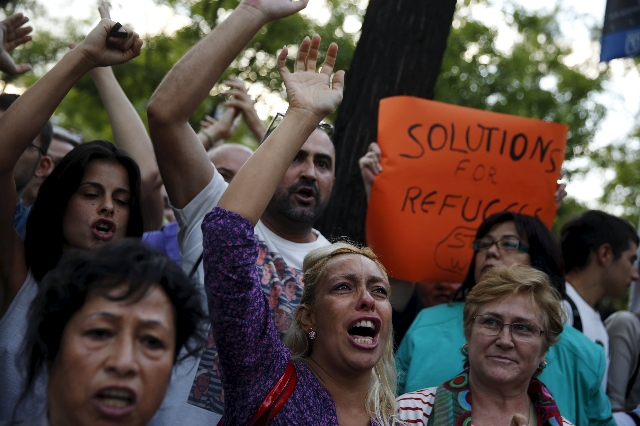 People take part in a demonstration asking for a change in the refugee policy in Europe outside the headquarters of the European Commission in Madrid, Spain, September 4, 2015. The municipalities  ...