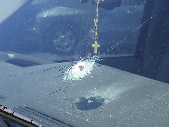A bullet hole is shown in a windshield of a car that was traveling on Interstate 10 in Phoenix, Sept. 1, 2015. (Arizona Department of Public Safety Handout/Reuters)