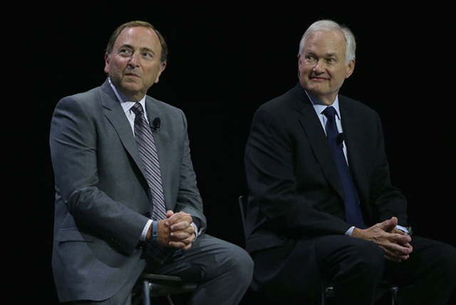 NHL commissioner Gary Bettman and NHLPA executive director Donald Fehr appear on stage together during a press conference and media event for the 2016 World Cup of Hockey at Air Canada Centre. (To ...