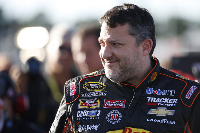 Sep 11, 2015; Richmond, VA, USA; Sprint Cup Series driver Tony Stewart (14) looks on prior to qualifying for the Federated Auto Parts 400 at Richmond International Raceway. (Amber Searls/USA Today ...