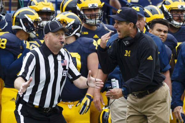 Sep 12, 2015; Ann Arbor, MI, USA; Michigan Wolverines head coach Jim Harbaugh reacts to a penalty in the second quarter against the Oregon State Beavers at Michigan Stadium. Mandatory Credit: Rick ...