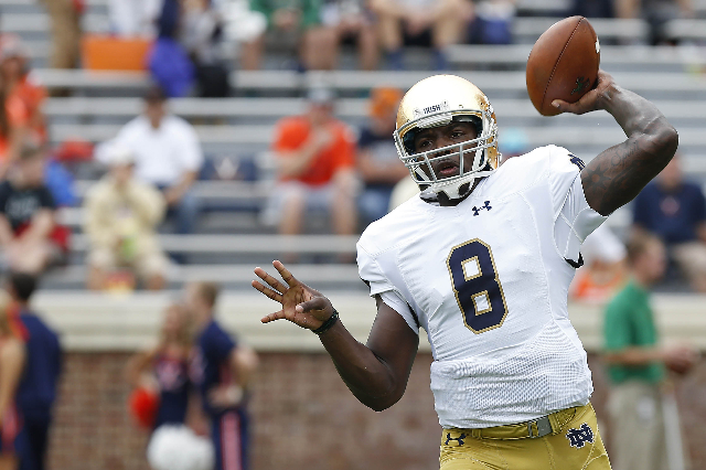 Sep 12, 2015; Charlottesville, VA, USA; Notre Dame Fighting Irish quarterback Malik Zaire (8) throws the ball during warm-ups prior to Fighting Irish' game against the Virginia Cavaliers at  ...