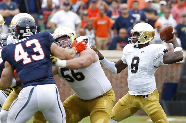 Sep 12, 2015; Charlottesville, VA, USA; Notre Dame Fighting Irish quarterback Malik Zaire (8) throws the ball as Virginia Cavaliers defensive end Trent Corney (43) defends in the first quarter at  ...