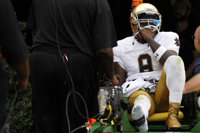 Sep 12, 2015; Charlottesville, VA, USA; Notre Dame Fighting Irish quarterback Malik Zaire (8) is carted off the field after injuring his right ankle against the Virginia Cavaliers in the third qua ...