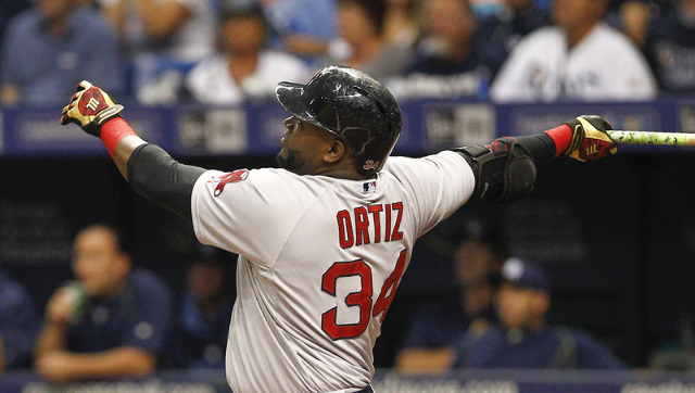 Sep 12, 2015; St. Petersburg, FL, USA; Boston Red Sox designated hitter David Ortiz (34) hits his 499th career home run during the first inning of a baseball game against the Tampa Bay Rays at Tro ...