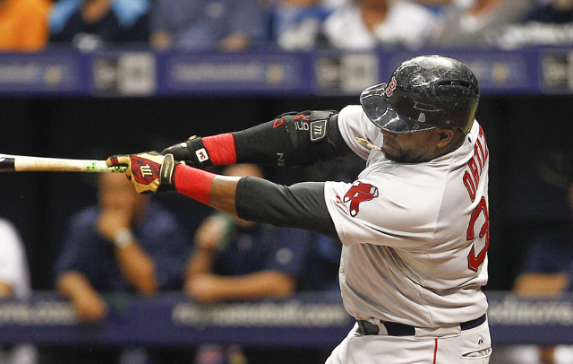 Sep 12, 2015; St. Petersburg, FL, USA; Boston Red Sox designated hitter David Ortiz (34) hits his 499th home run during the first inning of a baseball game against the Tampa Bay Rays at Tropicana  ...