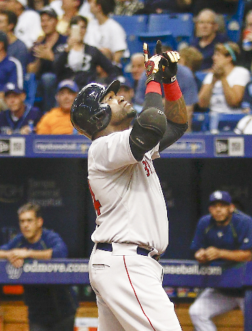 Sep 12, 2015; St. Petersburg, FL, USA; Boston Red Sox designated hitter David Ortiz (34) celebrates after he hits his 500th home run during the fifth inning of a baseball game against the Tampa Ba ...