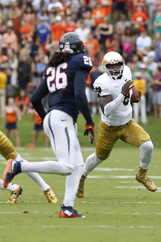 Sep 12, 2015; Charlottesville, VA, USA; Notre Dame Fighting Irish quarterback Malik Zaire (8) runs with the ball as Virginia Cavaliers cornerback Maurice Canady (26) chases in the first quarter at ...