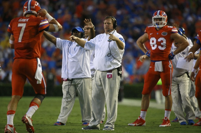 Sep 12, 2015; Gainesville, FL, USA; Florida Gators head coach Jim McElwain talks with quarterback Will Grier (7) against the East Carolina Pirates  during the first quarter at Ben Hill Griffin Sta ...
