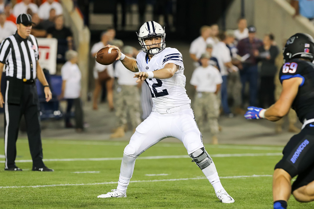Sep 12, 2015; Provo, UT, USA; Brigham Young Cougars quarterback Tanner Mangum (12) throws the ball during the first quarter against the Boise State Broncos at Lavell Edwards Stadium. Mandatory Cre ...