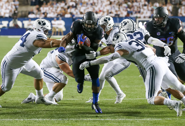Sep 12, 2015; Provo, UT, USA; Boise State Broncos running back Jeremy McNichols (13) runs the ball through a host of  Brigham Young Cougars and towards the end zone during the first quarter at Lav ...