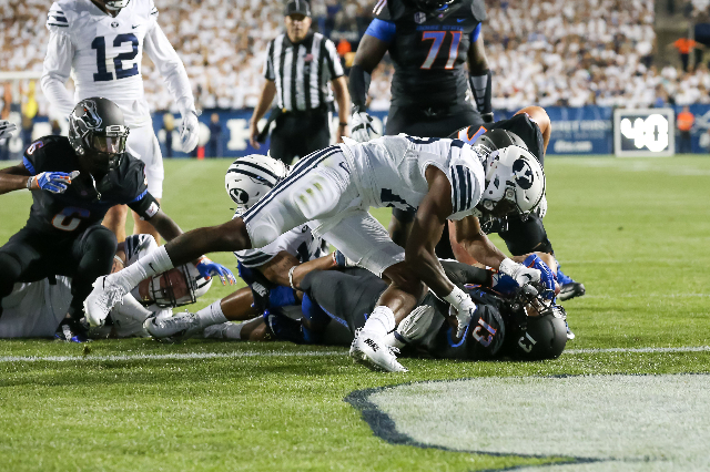 Sep 12, 2015; Provo, UT, USA; Boise State Broncos running back Jeremy McNichols (13) falls into the end zone for a touchdown against the Brigham Young Cougars during first quarter at Lavell Edward ...