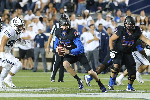 Sep 12, 2015; Provo, UT, USA; Boise State Broncos quarterback Ryan Finley (15) runs with the ball during the second quarter against the Brigham Young Cougars at Lavell Edwards Stadium. Mandatory C ...