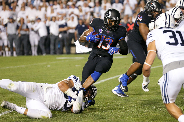 Sep 12, 2015; Provo, UT, USA; Boise State Broncos running back Jeremy McNichols (13) is tackled by Brigham Young Cougars defensive lineman Bronson Kaufusi (90) during the second quarter at Lavell  ...