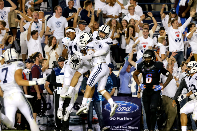 Sep 12, 2015; Provo, UT, USA; Brigham Young Cougars celebrate an interception and touchdown by defensive back Kai Nacua (12) against the Boise State Broncos during the fourth quarter at Lavell Edw ...