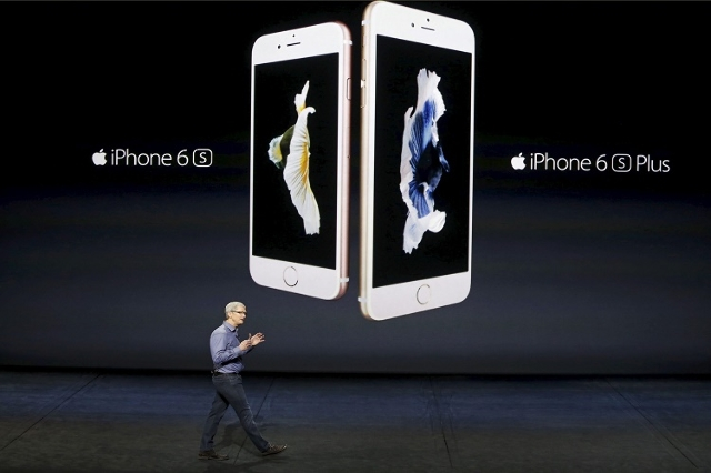 Apple CEO Tim Cook introduces the iPhone 6s and iPhone 6sPlus during an Apple media event in San Francisco, California, September 9, 2015.  Sales of Apple's new iPhones were on pace to beat  ...