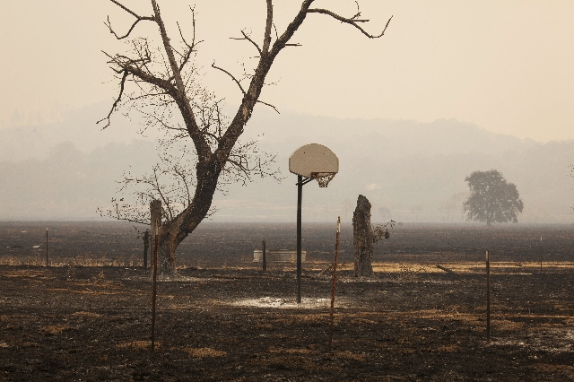 A basketball hoop is pictured at a burnt property during the so-called Valley Fire near Middleton, California, September 14, 2015. REUTERS/David Ryder