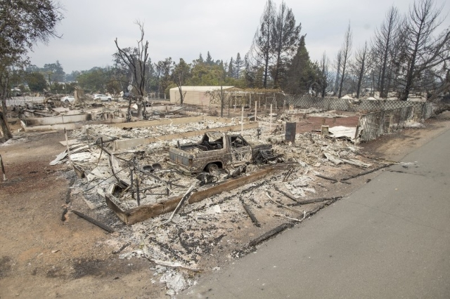 Leveled homes line Jefferson St. after the Valley Fire raged through Middleton, California September 14, 2015.  REUTERS/Noah Berger