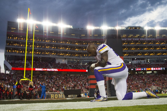 September 14, 2015; Santa Clara, CA, USA; Minnesota Vikings running back Adrian Peterson (28) prays in the end zone before the game against the San Francisco 49ers at Levi's Stadium. (Kyle T ...