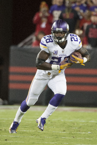 September 14, 2015; Santa Clara, CA, USA; Minnesota Vikings running back Adrian Peterson (28) runs with the football against the San Francisco 49ers during the second quarter at Levi's Stadi ...