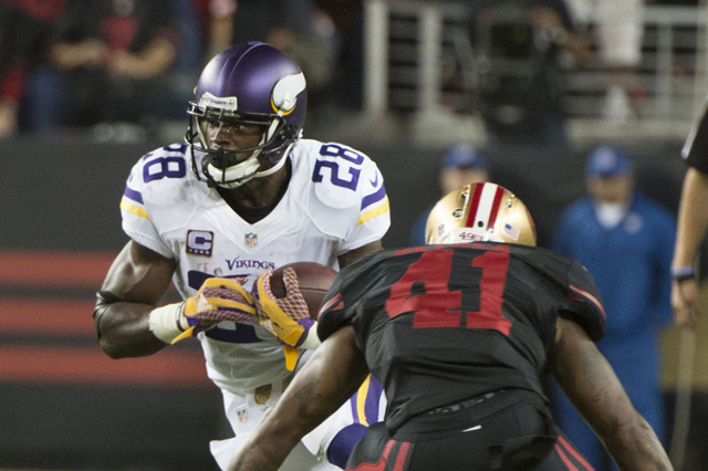September 14, 2015; Santa Clara, CA, USA; Minnesota Vikings running back Adrian Peterson (28) runs with the football against San Francisco 49ers strong safety Antoine Bethea (41) during the second ...