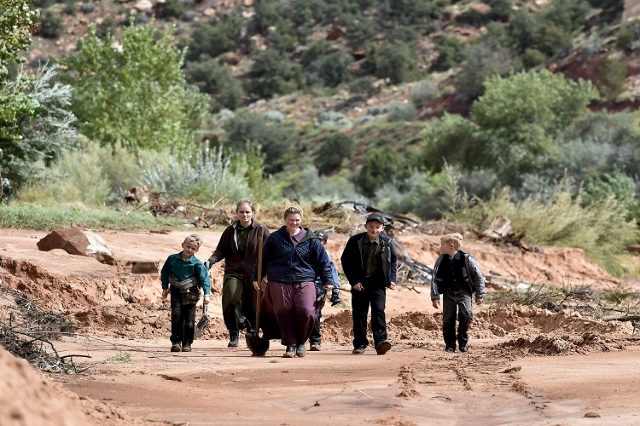 Residents walk along the bank of Short Creek while searching for missing residents after a flash flood in Hildale, Utah September 15, 2015. At least eight people were killed near Utah's bord ...