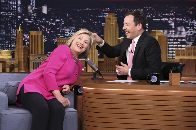U.S. Democratic presidential candidate Hillary Clinton has her hair pulled by host Jimmy Fallon (R) during an interview on the Tonight Show in New York. (Reuters/Douglas Gorenstein/NBC/Handout)