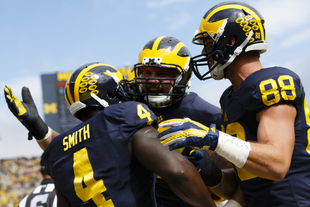 Michigan Wolverines running back De'Veon Smith (4) celebrates after scoring a touchdown in the first quarter against the UNLV Rebels at Michigan Stadium. (Rick Osentoski/USA TODAY Sports)