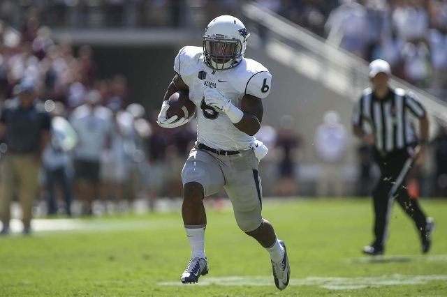Sep 19, 2015; College Station, TX, USA; Nevada Wolf Pack running back Don Jackson (6) runs the ball for touchdown during the first quarter against the Texas A&M Aggies at Kyle Field. (Troy Tao ...