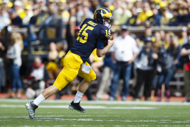 Michigan Wolverines quarterback Jake Rudock (15) scrambles in the first quarter against the UNLV Rebels at Michigan Stadium. (Rick Osentoski/USA TODAY Sports)