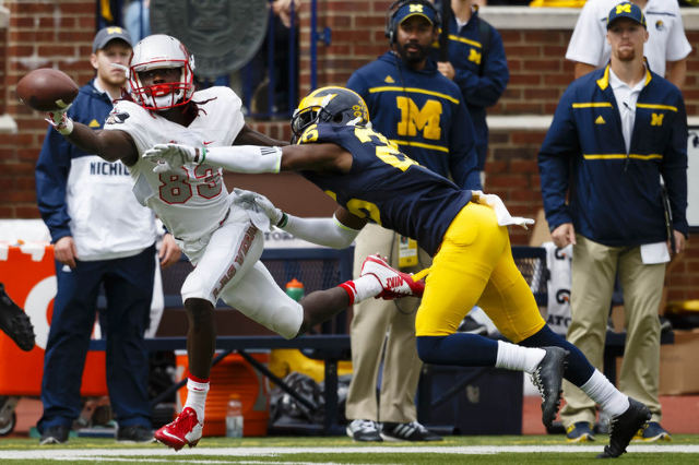 Michigan Wolverines cornerback Jourdan Lewis (26) breaks up a pass to UNLV Rebels wide receiver Devonte Boyd (83) in the second quarter at Michigan Stadium. (Rick Osentoski/USA TODAY Sports)