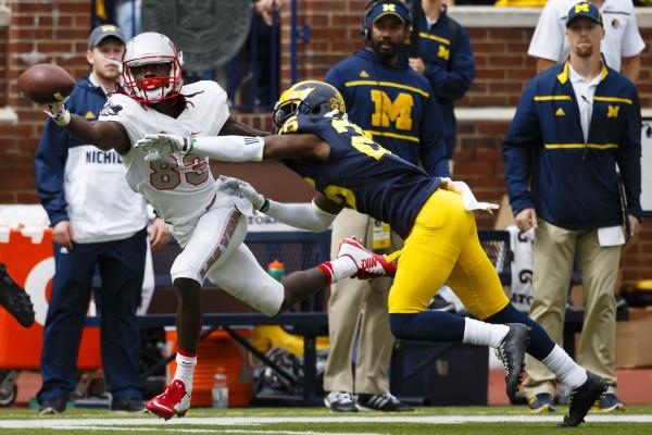 Sep 19, 2015; Ann Arbor, MI, USA; Michigan Wolverines cornerback Jourdan Lewis (26) breaks up a pass to UNLV Rebels wide receiver Devonte Boyd (83) in the second quarter at Michigan Stadium. Manda ...