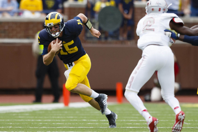 Michigan Wolverines quarterback Jake Rudock (15) rushes in the second quarter against the UNLV Rebels at Michigan Stadium. (Rick Osentoski/USA TODAY Sports)
