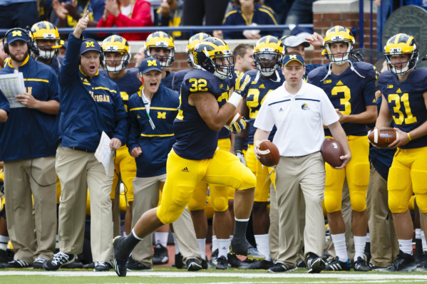 Sep 19, 2015; Ann Arbor, MI, USA; Michigan Wolverines running back Ty Isaac (32) runs the ball for a touchdown in the second quarter against the UNLV Rebels at Michigan Stadium. Mandatory Credit:  ...