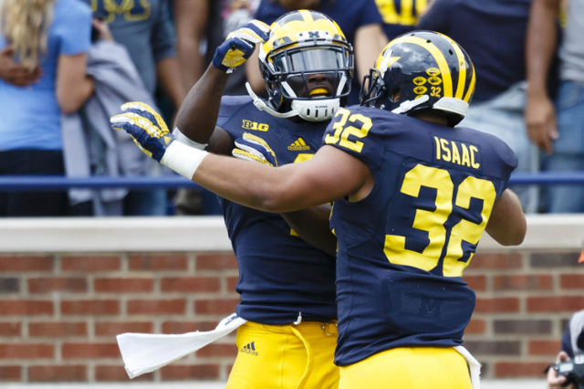 Michigan Wolverines running back Ty Isaac (32) receives congratulations from teammate after scoring a touchdown in the second quarter against the UNLV Rebels at Michigan Stadium. (Rick Osentoski/U ...